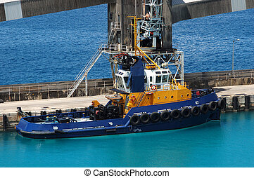 Blue tug boat in caribbean dock