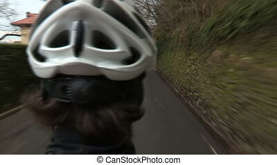 Cyclist going downhill