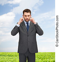 annoyed businessman covering ears with his hands - businss,...