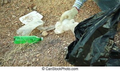 Cleaning Garbage Litter Close Up - Close up shot of an...