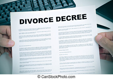 divorce decree - closeup of man hands holding a divorce...