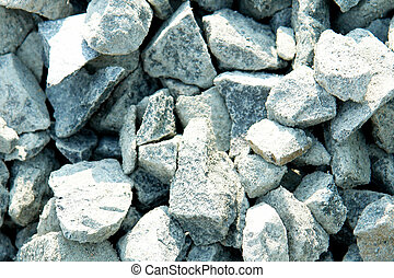 gravel - zoom of gravel gray rock. texture with light....