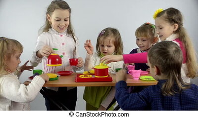 children and food - A group of children simulates cooking in...