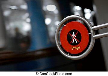 Metro - Warning sign far pedestrians with metro vehicle...