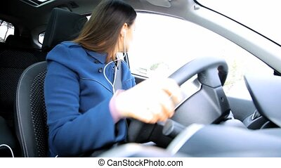 Serious woman driving