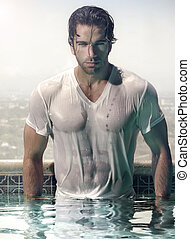 Man in pool - Gorgeous male model in soaked wet t-shirt...