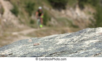 Cyclist going uphill on trail