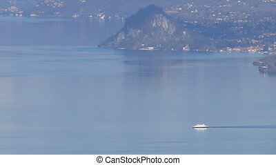 Ferry navigating on lake Maggiore, Italy