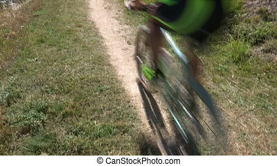 Cyclist going fast on trail - Cyclist going fast on mountain...