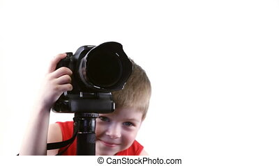 Little boy photographer in the studio