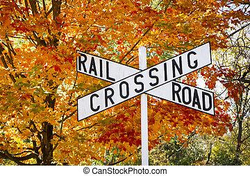 Autumn Railroad Crossing Sign - A railroad crossing sign...