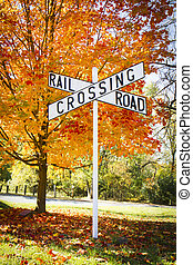 Autumn Railroad Crossing Sign - A railroad crossing sign...