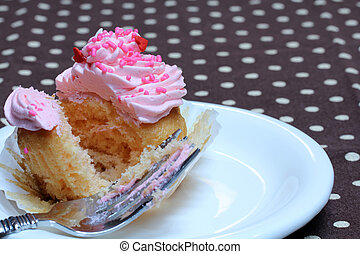 Cupcake with Pink Icing and Sprinkles