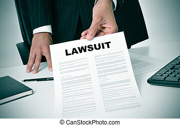 lawsuit - a lawyer in his office showing a document with the...