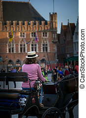 Coachwomen - Coashwoman taking tourist around Bruges Belgium...