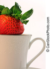 Fresh Red Strawberries inside a White China Teacup - Fresh...