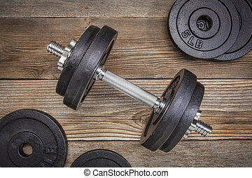 exercise weights - iron dumbbell with extra plates on a...