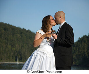 Wedding Couple Kissing Outdoors