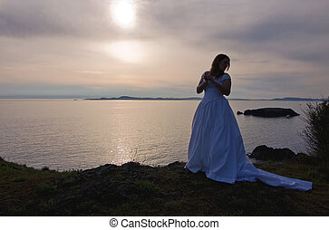 Silhouette of Bride At Sunset