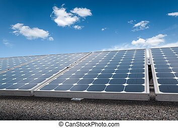 solar panels over blue sky - solar power for electric...