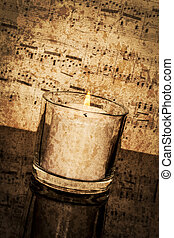 Candle with Vintage Sheet Music - Old classical sheet music...