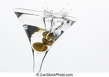 Martini Splash - A martini glass on a white background; the...