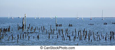 Jersey Sailboats - Sailboats are moored off the coast of New...