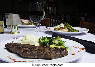 New York Strip Steak with Mashed Potatoes and Mixed...