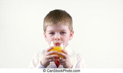 little boy drinks juice