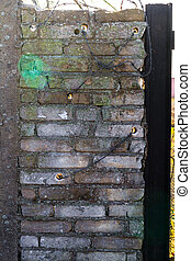 Protective brick wall topped barbed wire - Protective brick...