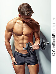 Young bodybuilder man exercising