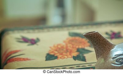 Zoom out of Asian Teapot on a table