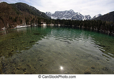 Clear water of the Lake with the Alps in the background 1 -...
