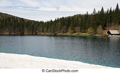 Alpine Lake with crystal clear water and the mountains 1 -...