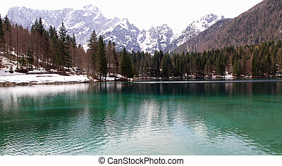 Alpine Lake with crystal clear water and the mountains 2 -...