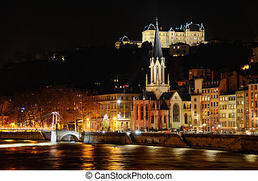 saint georges church next to the Saone river at night -...
