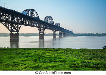 jiujiang yangtze river bridge in spring - beautiful jiujiang...