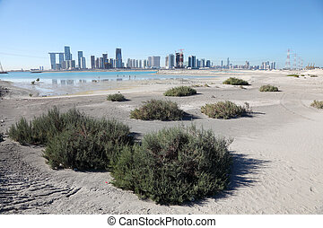 Abu Dhabi skyline as seen from Saadiyat Island beach, United...