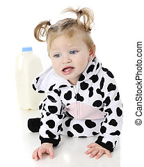 Moo! - An adorable baby girl in a cow costume, unhappily...