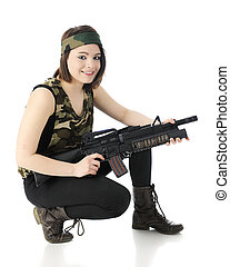 Happily Poised for Combat - A beautiful teen gilr wearing...