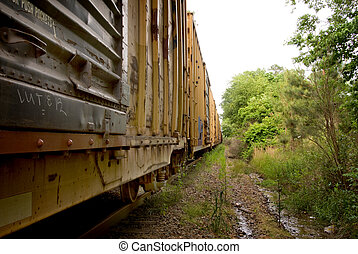 Boxcars - A long line of boxcars on a train track