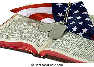 Armed Forces - Folded flag and dog tags on Bible.