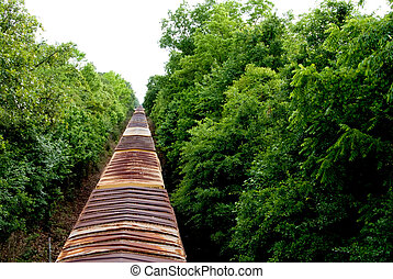Boxcars - A long line of boxcars on a train track.