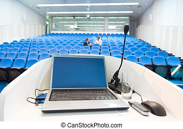 Laptop on the rostrum in conference hall - Laptop and...