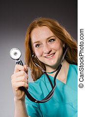 Woman doctor with the stethoscope