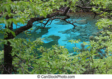 crystal-clear Alpine Lake pristine water in the middle of...