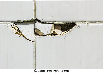 Broken tiles. - Close Up texture of white broken tiles on...