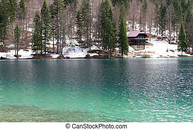 alpine hut on the shore of the Lake with fresh water and...