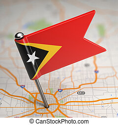 East Timor Small Flag on a Map Background - Small Flag of...