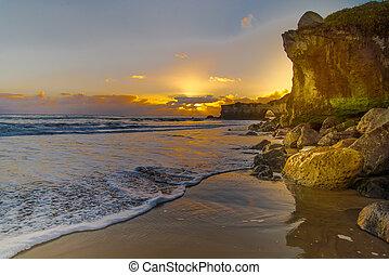 Sunset on beach with rocks - Santa Cruz lighthouse beach at...